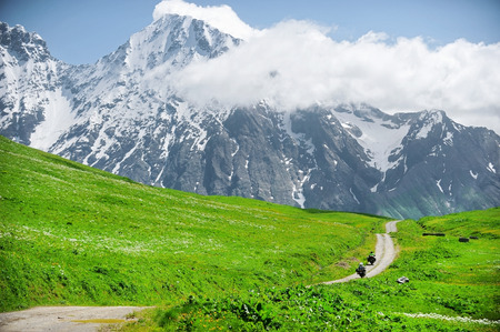 Adventure motorcycles riding the Zagar mountain Pass in the Caucasus Mountains Stock Photo