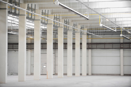 heated: Interior detail with an empty industrial storage depot with ceiling heating system