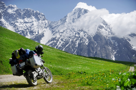Adventure motorcycle on the Zagar mountain Pass in the Caucasus Mountains in Georgia Archivio Fotografico