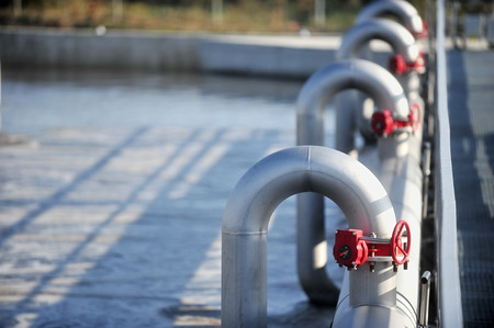 Industrial pipes from a waste water treatment plant Stockfoto