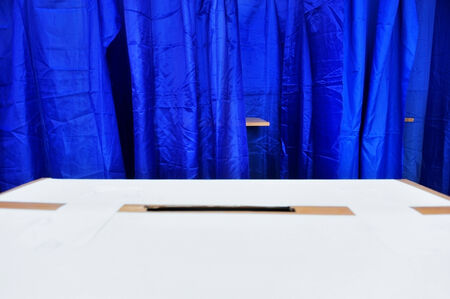 voting booth: Empty vote booth and part of a ballot box are seen during election process Stock Photo