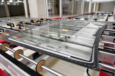 auto glass: Industry detail with a rear car glass on the production line in a glass factory