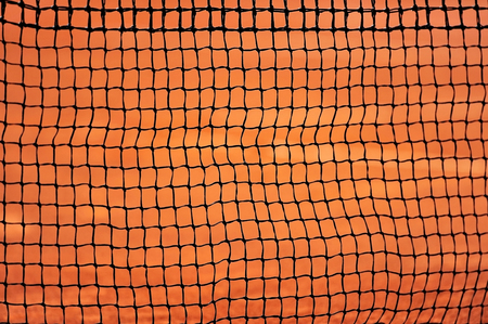 tennis net: Sport detail shot with a tennis net on a clay court
