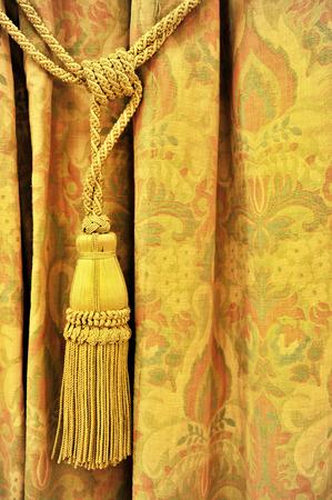 yellow tassel: Detail shot with a yellow curtain decorative tassel