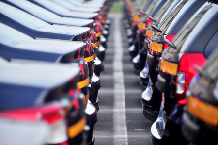 industrial park: Outdoor detail shot with lot of brand new cars in a row Stock Photo