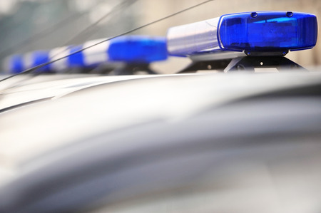 Detail with police blue siren lights on a car