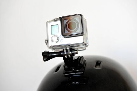 an action: Detail shot with action camera mounted on a sports helmet
