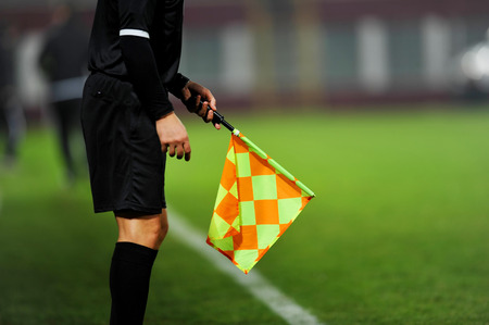 Assistant referees in action during a soccer match Stockfoto