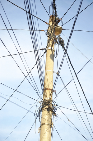 wire mess: Public electricity pole with lots of tangled wires