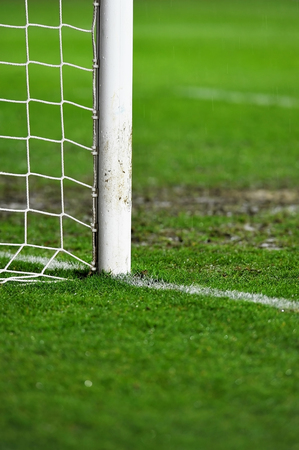 Sports shot with a soccer goal detail on rainy day