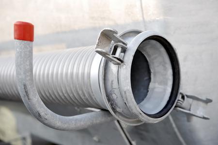 Industrial metal hose from a cistern reservoir