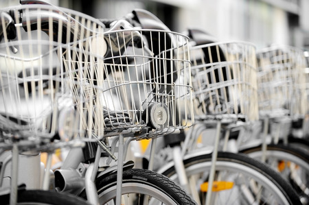 velo: City bicycles with front basket are seen in a rental station