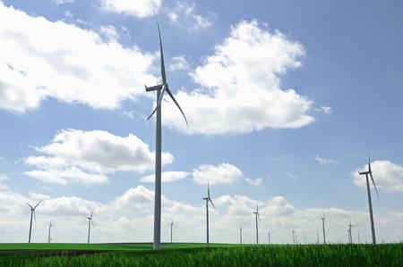 kinetic energy: Wind turbine farm on a green field in springtime