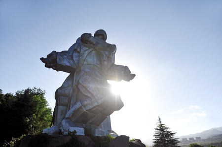 comrade: Huge soviet silver statue of a soldier holding a dying comrade representing the World War Two Memorial in Dilijan, Armenia.