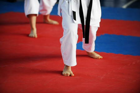 karate fighter: Feet of two karate practitioners are seen on the competition floor