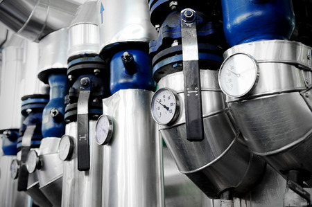 control power: Industrial shot with a manometers and heating pipelines inside a water heating station Stock Photo