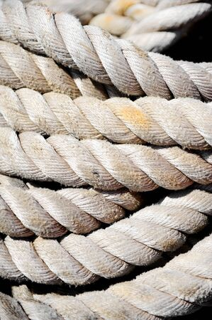 cable knit: Industrial detail with a heap of old maritime sea ropes