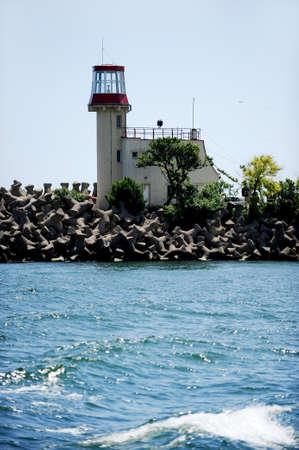 deserted: Deserted lighthouse on the sea coastline Stock Photo