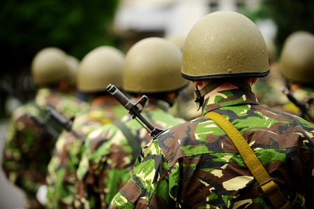 Group of unrecognizable soldiers in camouflage uniform ready for war Stock Photo