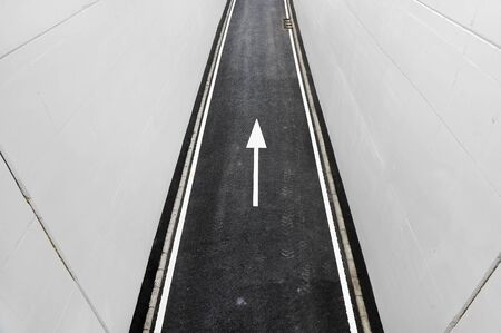 one lane sign: Industrial shot with a new asphalt two lane road coming out of a tunnel Stock Photo