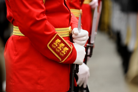 bayonet: Detail with the hands of a soldier on a bayonet rifle in rest position during a military parade