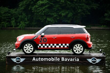 cooper: BUCHARESTROMANIA - JUNE 26: Advertising campaign with a Mini Cooper floating on a platform on a lake, on June 26, 2015 in Bucharest.