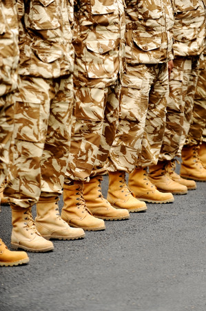 discipline: Soldiers feet in desert camouflage military uniform in rest position