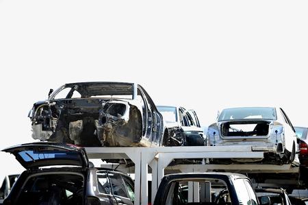 scrapyard: Wrecked vehicles are seen in a car junkyard