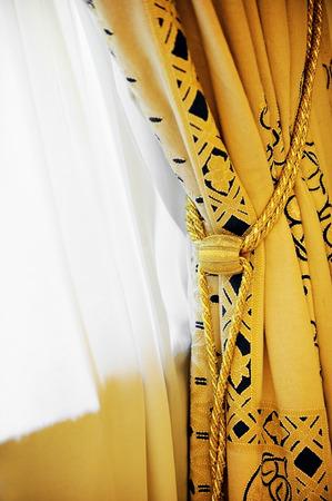 yellow tassel: Luxury yellow window curtain with decorative tassel Stock Photo