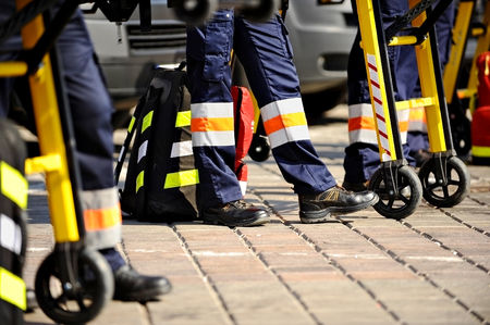 urgent care: Ambulance personnel feet are seen next to emergency equipment