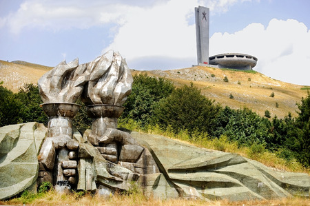 communists: Pair of hands holding torches that sits at the bottom of Buzludzha communist monument, who once served as the House of the Bulgarian Communist Party. Stock Photo
