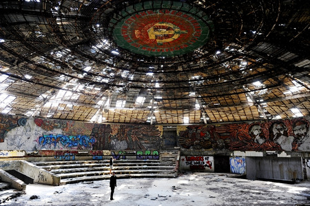 historic buildings: MOUNT BUZLUDZHABULGARIA - AUGUST 14: Two people inside Buzludzha communist monument, who once served as the House of the Bulgarian Communist Party, on August 14, in Bulgaria.