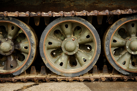 battle tank: Detail shot with old tank tracks and wheels Stock Photo
