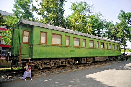 dictator: GORI, GEORGIA - JULY 2: A woman resting on the steps of Stalins railroad car in the museum dedicated to the soviet dictator, on July 2, 2014 in Gori. Editorial