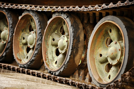 military tank: Detail shot with old tank tracks and wheels Stock Photo