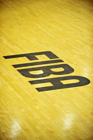 international basketball: BUCHAREST, ROMANIA - JULY 31: International Basketball Federation (FIBA) logo is seen on a basketball court on July 31, 2015 in Bucharest.