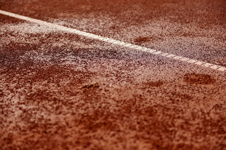 tennis clay: Detail shot with a wet tennis clay court Stock Photo