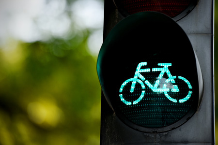 switched: Detail shot with a bicycle traffic light switched to green colour