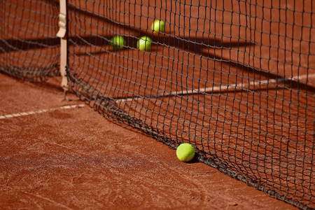 tennis clay: Detail shot with tennis balls close to the net on a tennis clay court Stock Photo