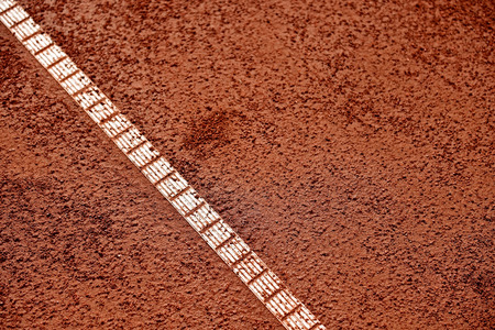 sideline: Detail with sideline and moisture on a tennis clay court Stock Photo