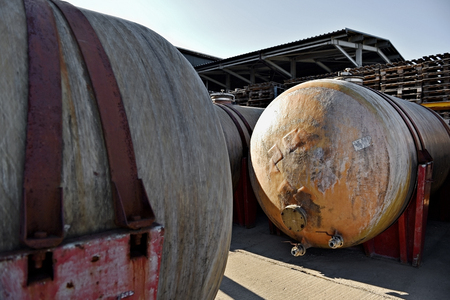 ferment: Industrial detail with big fiber glass tanks for wine storage