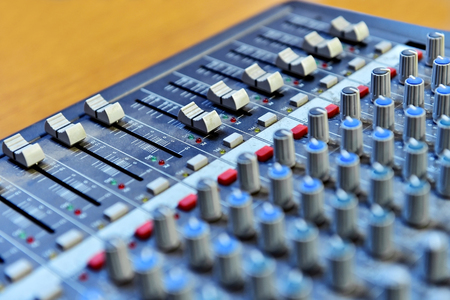 soundboard: Detail with adjusting knobs on a professional audio mixer