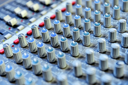 adjusting: Detail with adjusting knobs on a professional audio mixer