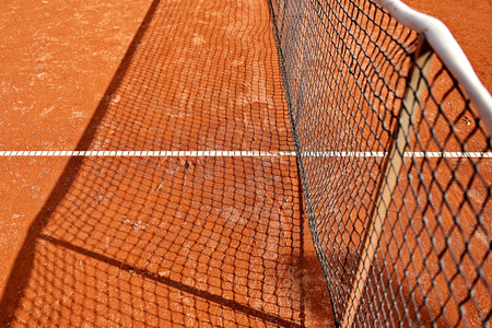 tennis clay: Detail shot with a tennis net on a tennis clay court