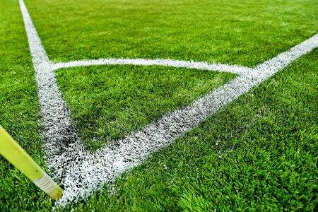 sideline: Closeup shot with a fresh painted sideline on a turf soccer field