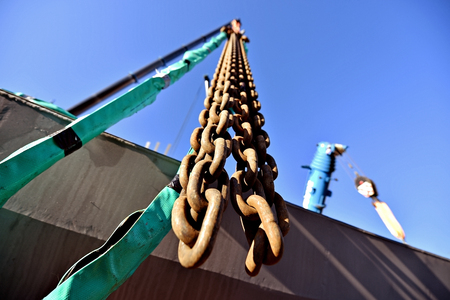 hooked: Heavy duty industrial chain hooked up on a construction crane