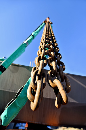 hooked up: Heavy duty industrial chain hooked up on a construction crane