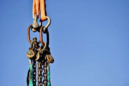 heavy duty: Heavy duty industrial chain hooked up on a construction crane