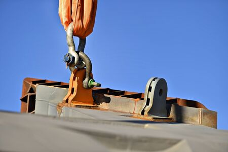 hooked up: Heavy duty industrial chain hooked up on a construction crane for lifting up concrete structure