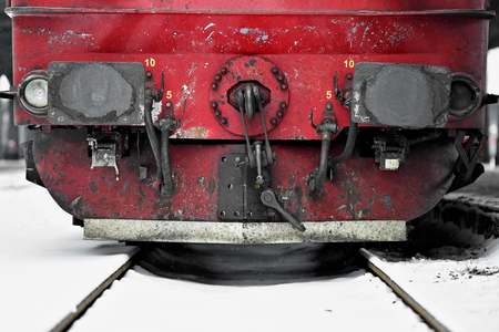 buffers: Detail shot with train wagon buffers and connection links in winter Stock Photo